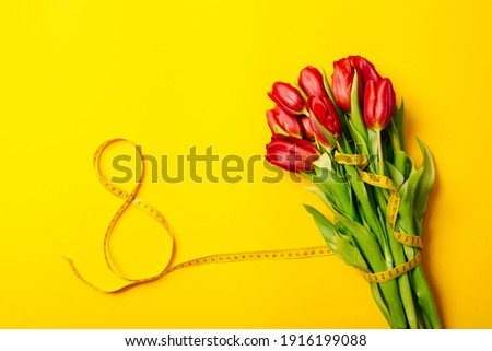 Banner with lush bouquet of red tulips and number eight on a yellow background with copy space, empty text place. International woman day March 8. Mother Day. Gift certificate. Mockup. Greeting card. Photo stock ©