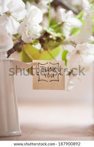 Banner with thank you and white spring blossoms as background.