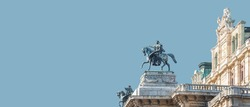 Banner with top roof sculpture of Greek goddess Muse riding Pegasus, a winged horse, at Vienna State Opera House, Vienna, Austria, with copy space. Concept of Cultural Heritage and Travel