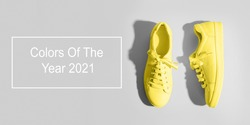 Banner with yellow female gumshoes on grey background. View from above. Space for text.