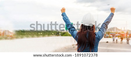 Banner Woman engineer entrepreneur constrcution industry worker. Panoramic Female engineer working refinery oil plant manufacturing. Young civil engineering construction wear hardhat safety helmet