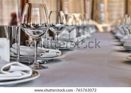 Banquet hall in the restaurant. Concept: Serving. Celebration. Anniversary. Wedding - Shutterstock ID 765763072