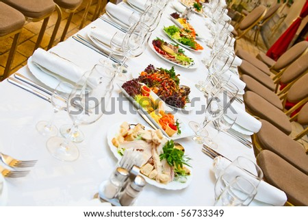 Banquet. Table with food. Glasses, plates and forks.