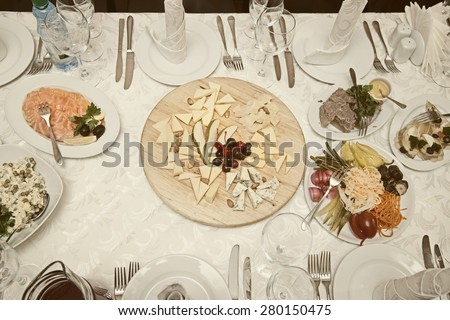 Banquet table with the dishes in the restaurant view from above