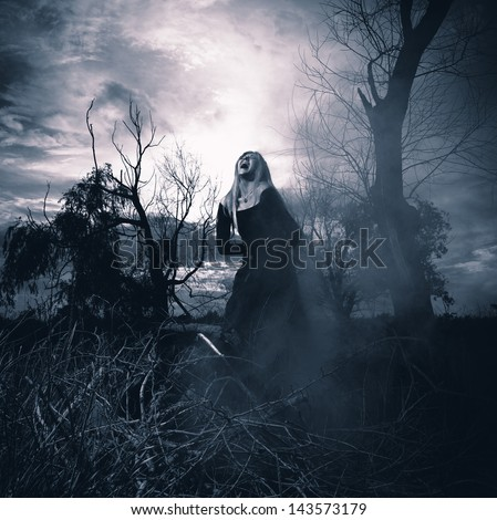 Banshee. Fantasy style portrait of a howling woman, monochromatic shot