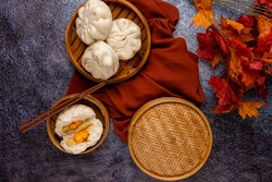 Baozi or Bakpao is a type of yeast-leavened filled bun in various Chinese cuisines. There are many variations in fillings (meat or vegetarian) and preparations, though the buns are most often steamed.