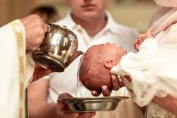Baptism ceremony in Church. baptism holy water Catholic.