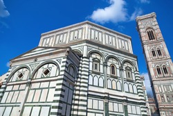 Baptistery of San Giovanni and Bell Tower in Florence. Italian Gothic style. Landmark of Tuscany.  June 2017.
