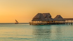 Bar and cafe on water at sunset in Zanzibar, Tanzania