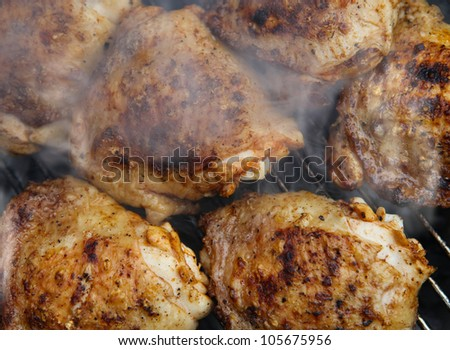 Bar-B-Q or BBQ with chicken cooking. coal grill of chicken meat. barbecuing dinner