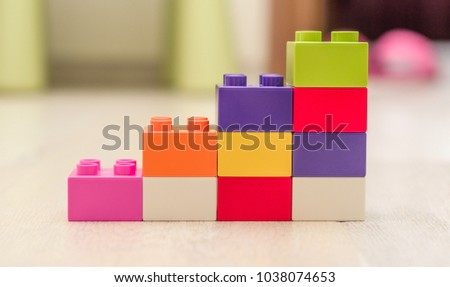 Bar chart created from toys. Conceptual image symbolizing things are on the rise, increasing, made from toys. #1038074653