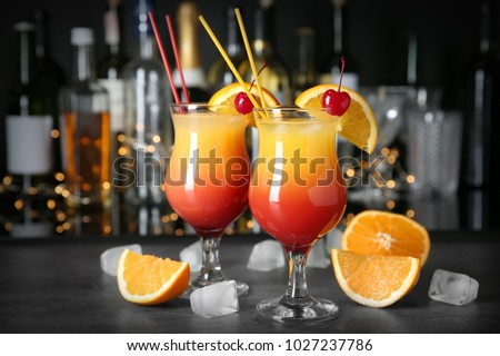 Bar counter with glasses of cocktail Sex on the Beach