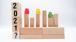 Bar graph represented by wooden blocks to present topics on educational proficiency, continous improvements and performance development