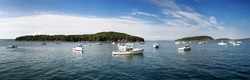 Bar Harbor panorama, showing small fishing boats anchored in the bay. Maine, USA
