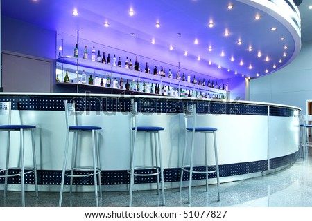 Bar interior with round couter and stools
