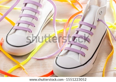 Bar laced white sneakers with violet shoelaces. Cool idea to style up your favorite pair. Footwear, custom design, lacing. #1551223052