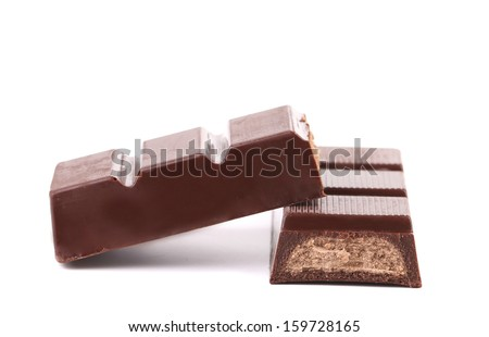 Bar of chocolate with a filling. Isolated. On a white background