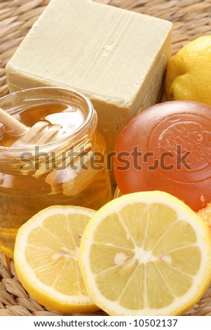 bar of gliceryne soap jar of honey and lemon - natural bath - stock photo