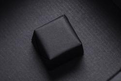 Bar of homemade soap bar infide of black carton box