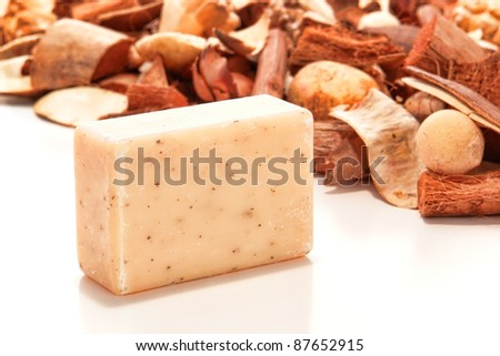 Bar of natural artisan made Marseilles aromatherapy bath soap with potpourri for a pampering cleansing session in a spa on white