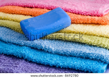 bar of soap on a pile of colorful towels