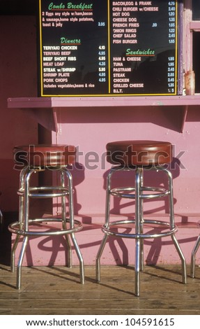 Bar stools at an outdoor hamburger stand, Los Angeles, CA