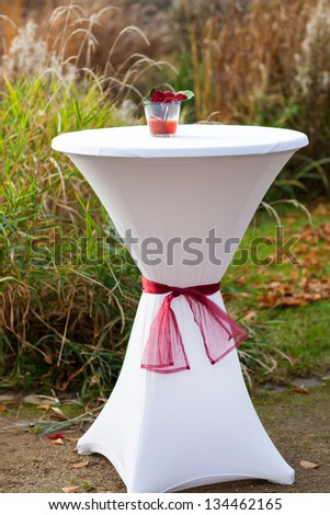 Bar table decorated with flowers for outdoor autumn wedding