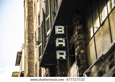 bar text on a wall. it is bar...