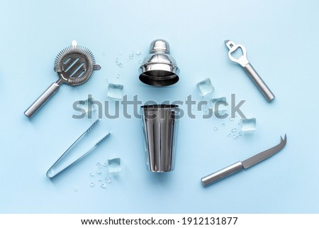 Bar tools and utensils for cocktail - with shaker, strainer and ice Stock photo ©
