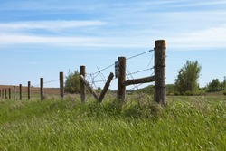 Barb Wire Fence With a No Hunting Sign