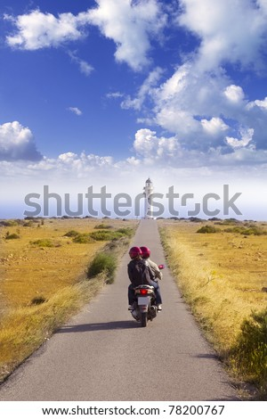 Barbaria cape formentera lighthouse road tourist couple in bike