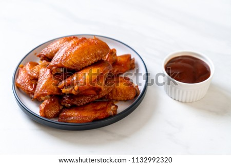 barbecue chicken wings with sauce #1132992320