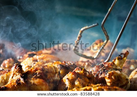 Barbecue chicken with cherbs on Grill