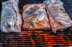 Barbecue cooking flaming grill grid Food Background in aluminum foil
