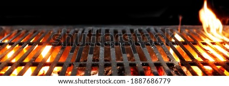 Barbecue Fire Grill Isolated On Black Background. BBQ Flaming Charcoal Grill Isolated. Hot Barbeque Charcoal Cast Iron Grill With Bright Flames Of Fire. Abstract Panoramic Grill Wide Banner. Stock photo ©