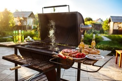Barbecue grill party. Tasty food on wooden desk.