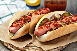 Barbecue Grilled Hot Dog with ketchup on wooden table