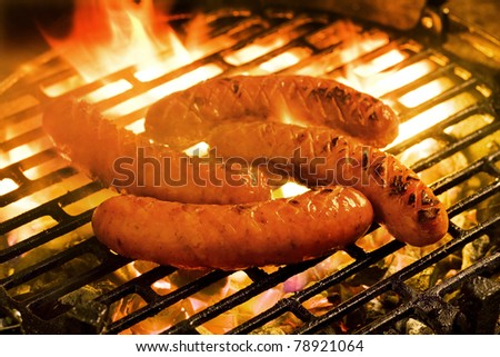 Barbecue - Grilling sausages on a charcoal grill
