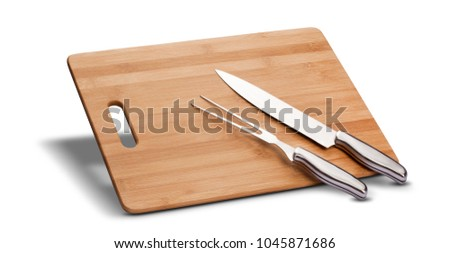 Barbecue kit with wood to cut meat, knife and long fork, isolated in white background. #1045871686