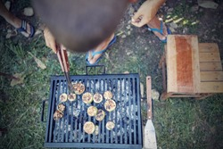 Barbecue making outdoors on a regular / vintage grill.
