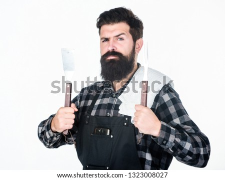Barbecue master. Bearded hipster wear apron for barbecue. Roasting and grilling food. Man hold cooking utensils barbecue. Tools for roasting meat outdoors. Picnic and barbecue. Cooking meat in park.