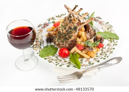 barbecue ribs on a plate with vegetables, fries and mushrooms