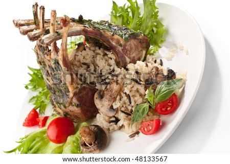barbecue ribs on a plate with vegetables, rice and mushrooms