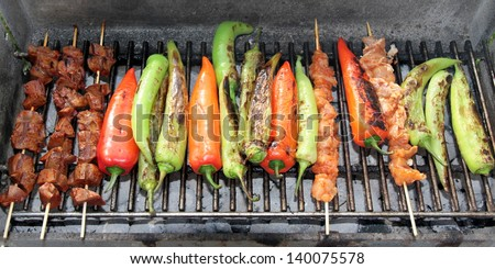 Barbecue. Shish kebab and grilled peppers on hot grill