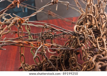 Barbed wire and chain of sorrow linked in each other