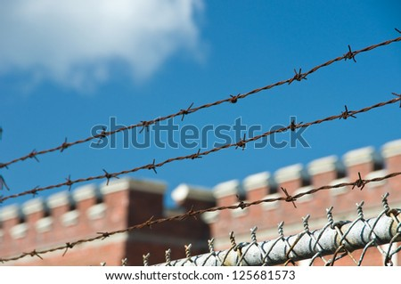 Barbed wire and fence on castle and sky background
