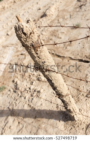 barbed wire fence in the nature #527498719