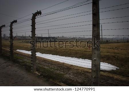 Barbed wire fencing at Auschwitz in Winter Fog