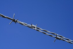 Barbed wire with a blue sky background