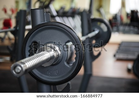 Barbell ready to workout, indoors, shallow DOF